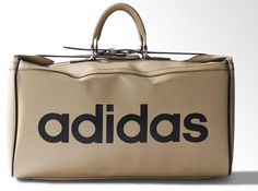 Out of the archives and back on the shelves comes this 1970s Adidas Team Bag. It's a stunner too. Described as 'a faithful re-issue of an archival '70s style', the bag is made on an imitation leather and in a 'boxy' shape that should make it useful for smaller luggage, complete with metal trim, double handles, special closure with two belts from side panels closing over main zip and of course, that bold vintage Adidas logo on the side.  Available directly from Adidas, it retails for £105.