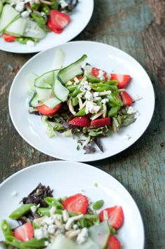 Strawberries, ribbons of cucumber, slivered almonds, crumbled goat cheese and sliced snow peas (or sugar snap peas) all on a bed of soft butter lettuce.