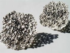 Patrycja Zwierzynska  Lichen Brooches, 2012  Sterling silver, cast  3 x 3 x 1/8 inches  L.A. Pai Gallery
