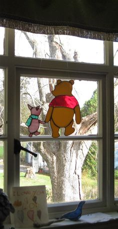 Best friends forever, Pooh and Piglet walking hand in hand.  Classic Winnie made from yellow opal stained glass, with his red shirt made from water glass. His sweet little friend Piglet has a pink and white streaky glass body, and a striped green and white wispy glass scarf.  This piece measures 8 x 8, and comes ready to hang with monofilament line.  Great gift for a special friend or for whimsical decor in a childs or babys room.  This piece is made in the Tiffany style, with hand cut…