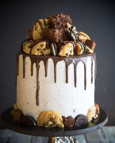 This cake is a mouthful, quite literally. Layers of chocolate and white cake are separated by brownie bits, Oreos, chocolate chip cookies, whipped vanilla buttercream, as well as chocolate buttercream!