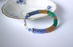 Bead crochet rope bracelet in blue, gold and green by BibaStore on Etsy