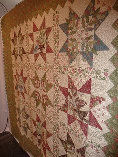 beautiful quilt...love the applique within the block..sashing compliments the quilt as well...nicely done ;)