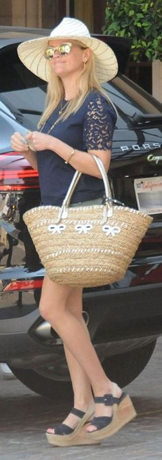Reese Witherspoon': Hat – Ace of Something  Shoes – Prada  Shirt and bag – Draper James  Bracelet – Miansai