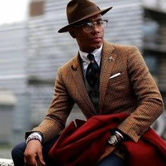 Brown suiting inspiration with a gingham blazer collar bar collar white shirt brown fedora brwon silk tie lapel pin brown lined white pocket square watch wrist accessories red topcoat Der Gentleman, Gentleman Style, Sharp Dressed Man, Well Dressed Men, Best Dressed Black Men, Outfits Hombre, Best Mens Fashion, Men's Fashion, Fashion Styles