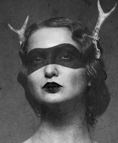 mysterious woman in black & white portrait image. Mask painted face & eyes with antler horns. Great art form.