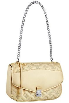 Absolutely love this Louis Vuitton purse.....hmmm one day...