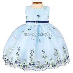 Light Blue Floral Embroidered Organza Baby Dress: This adorable bright light blue baby dress will be the perfect option for any garden party or spring wedding. The soft light colors on this baby dress are simply delightful, while the light fabric makes this dress easygoing and comfortable for your little angel to move around in.