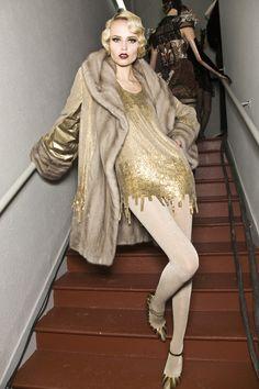 TAN/gold ombre sequins dress, tan stockings, tan/gold shoes and fur coat.  Natasha poly