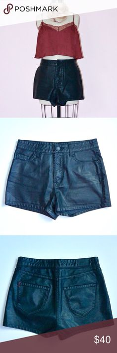 """BDG Vegan Leather Shorts Look like a real bad ass (while low-key bein' eco-friendly 'bout it) in these faux leather shortie shorts. Features 5 pocket styling, high-waisted fit, and signature BDG red stitching on back pocket.  Brand: BDG for Urban Outfitters Size: 27* (*sizes are arbitrary! see measurements) Material: 100% polyurethane Measurement around top edge: 29"""" Measurement around hip point: 37""""  Length along outter edge: 12"""" Length of rise (from top of button to crotch): 11"""" Urban…"""