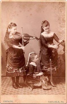 Making music in Germany.  Beautiful hair, beautiful dresses, beautiful girls.