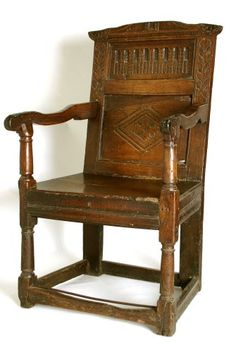 Oak Armchair with carved panel back, turned baluster legs and arm supports, plain back legs and stretchers. Circa 1640.