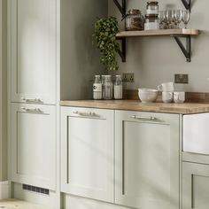 Pale enough to work as a neutral, the sage green tone of these sturdy, 20mm-thick doors makes a great choice for those that want a subtle style with plenty of country character. Choose from a wide variety of cupboards, such as larder units, which can keep cooling devices hidden from view to help maintain an uninterrupted design. Light Green Kitchen, Green Kitchen Island, Green Kitchen Walls, Sage Kitchen, Shaker Kitchen Cabinets, Kitchen Colour Schemes, Kitchen Cabinet Colors, Home Decor Kitchen, Kitchen Interior
