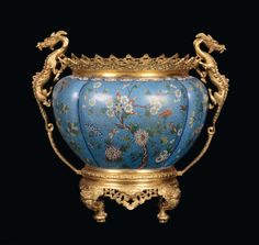 Chinese Qing Dynasty (1644-1911) bronze framed cloisonne urn.