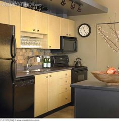 I love the colors in this kitchen very modern and for Kitchen cabinets vancouver island