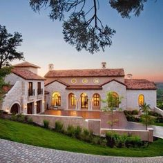 Love the Hacienda style exterior.. white stone & tan color...