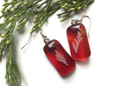 Check out Streaky Red Colored Fused Glass Drop Earrings, Red Dangle Earrings, eco jewellery, gifts for her, nature jewelry, real plant jewelry on thejeremiahtreeglass
