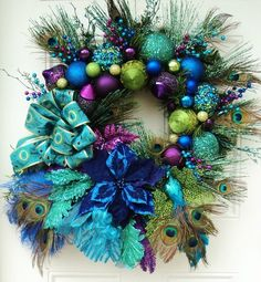 miobello: Peacock wreath is beautiful. Great for Mardi GrasChristmas Peacock Wreath XXL by ViennaSparkleWreaths on .miobello: Peacock wreath is beautiful. does it harm the Peacock, or do we normally get the feathers through a shedding process? Holiday Wreaths, Holiday Crafts, Holiday Fun, Christmas Decorations, Holiday Decor, Peacock Christmas, Blue Christmas, All Things Christmas, Peacock Wreath