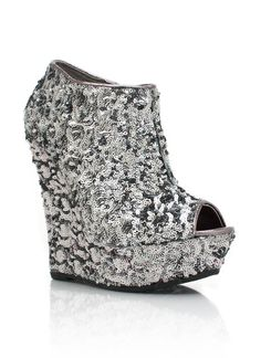 These are so radd... I love them in Rose Gold.... Check out these sequined peep-toe wedges $30.80 at GoJane.com