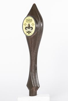 """Fleur-de-lis"" — Robert Trempe. Seasonal and limited release beers should be celebrated with specific taps as distinctive as the beers themselves. This tap handle is designed for the late-spring Yards Saison. The handle is shaped by an interpretation of the decorative French ""Fleur-de-lis"" symbol found on the Yards Saison label. The proportions of the tap deviate slightly from the symbol for ergonomics, but the shape and texture retains its symbolism and connection to the Saison."