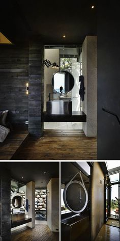 In this modern bathroom, a round mirror is hung above the aluminum sink and wooden vanity. Around the corner from the vanity is the shower that gets plenty of natural light from the skylight and door leading outside.