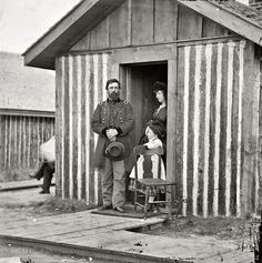 "1865. ""City Point, Virginia. Brig. Gen. John A. Rawlins, wife and child at Grant's headquarters."