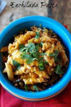 Enchilada pasta with lean ground turkey, corn, black beans, enchilada sauce and lots of cheese! #recipe #apeekintomyparadise