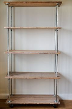 Industrial strength shelving from plumbing supplies  by Julie Ranee Photography