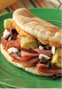 Delight in our Grecian Flatbread Sandwich, so fancy it seems wrong to call it a mere sandwich. This Grecian Flatbread Sandwich features roasted red pepper hummus, ham and feta wrapped in a soft pita bread. Flatbread Sandwiches, Flatbread Recipes, Wrap Sandwiches, Soup And Sandwich, Sandwich Recipes, Sandwich Buffet, Chicken Flatbread, Wraps, Kraft Recipes