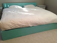 Ikea Malm king bed frame painted and refinished with Annie Sloan Chalk Paint (1 part Florence to 6 parts Pure White) to create a nice aqua shade, then coated with Annie Sloan Soft Clear Wax.