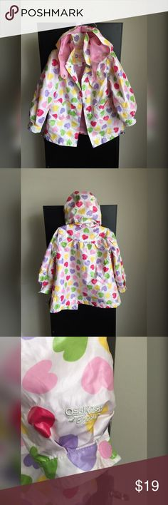 """Baby Girl """"OshKosh B'gosh"""" Lightweight Rain Jacket Rainy days can stay as long as she's got this awesome """"Osh Koosh"""" Toddler raincoat! Cozy pink terry lining provides warmth on chilly days with heart designed front pockets. Super Cute! LIKE NEW! Removable hood with snaps. Long sleeve design. Full snap front. Osh Kosh Jackets & Coats Raincoats"""