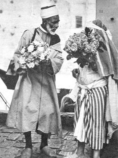 Tangiers 1940 - A Flower Seller from the Jebel with a Town Customer - James Jarche, Photographer