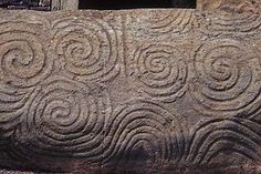 Google Image Result for http://upload.wikimedia.org/wikipedia/commons/thumb/6/62/Newgrange_Entrance_Stone.jpg/280px-Newgrange_Entrance_Stone.jpg
