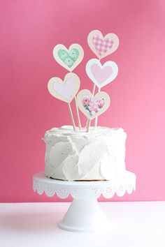 Make your Valentine's Day extra special with this DIY Layered Heart Cake Topper! So easy to make and so perfect for dressing up a plain cake! Diy Valentine's Cake, Diy Cake Topper, Birthday Cake Toppers, Cupcake Toppers, Fun Valentines Day Ideas, Valentines Day Cakes, Plain Cake, Watermelon Cake, Heart Cakes