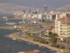 Izmir Izmir is the pearl of the Aegean, a fascinating city whose history begins in the mists of legend. Turkey's… I Love The World, Hotels, Travel Souvenirs, Black Sea, San Francisco Skyline, Places To Travel, Paris Skyline, Istanbul, Dolores Park