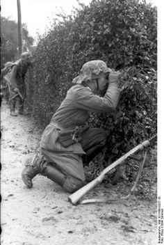 I spy with my 6X30 eyes. Normandy, 1944.