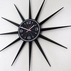 """LARGE MID-CENTURY BLACK STARBURST WALL CLOCK  Very nice condition MCM wall clock in all black and white with a red second hand. This bold design looks great in any setting, and functions perfectly as well. Its span of 29"""" will make it a strong focal point of your room. Wall Clocks, Mid-century Modern, Mid Century, Strong, Black And White, Nice, Interior, Kitchen, Red"""