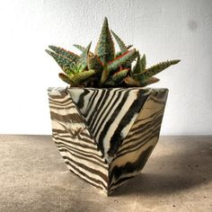 Marbled stoneware planter. Available Here