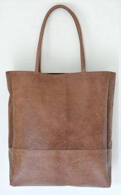Great office leather bag. cool color..I've got the black one bt, now i want this one too!