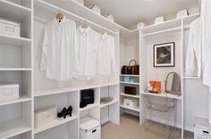 Contemporary Closet with Clear Arm Chair, Built-in bookshelf, Carpet, California Closets Walk-In Closet Custom Cabinetry