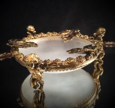 A personal favorite from my Etsy shop https://www.etsy.com/listing/254038155/antique-jewelry-box-ormolu-dish-vanity