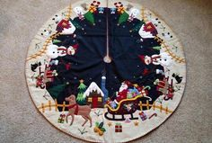 This Santa in Sleigh in Snowman Village scene has wonderful detail! It is pieced from wool flannel and felt, embroidered and whip stitched around the edges and tiny glass bead detail. The front background is black with soft white snow. Xmas Tree Skirts, Christmas Tree Skirts Patterns, Christmas Skirt, Cute Christmas Tree, Felt Christmas Decorations, Christmas Sewing, Christmas Knitting, White Christmas, Christmas Crafts