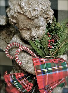 Garden cherub dressed in Christmas plaid