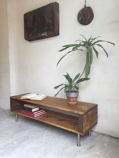 This is a classic industrial rustic style TV console, media unit or coffee table. Made from stained timber with four stainless steel legs and