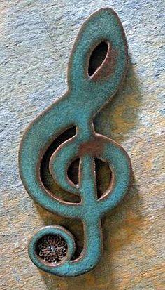 Ceramic treble clef wall hanging. $22.00, via Etsy.