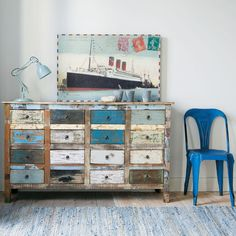 vintage wooden chest of drawers, nautical art. yes to all of it.