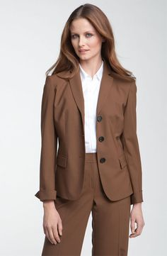 Brown hair- brown suit  Where's the green top?