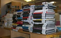Stacked up, weeded books waiting for reclassmarking and transferring ; photographed by Clemens Gresser.