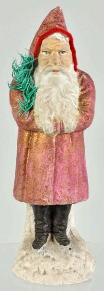 "German Belsnickel Santa in red holding a fir tree with   Size 11"" T., price realized $ 1,020"
