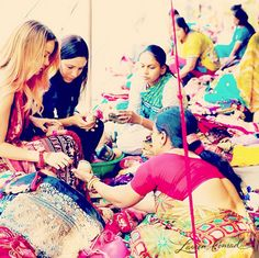 Love this photo of Lauren Conrad in India at the market. Love how colorful India is.